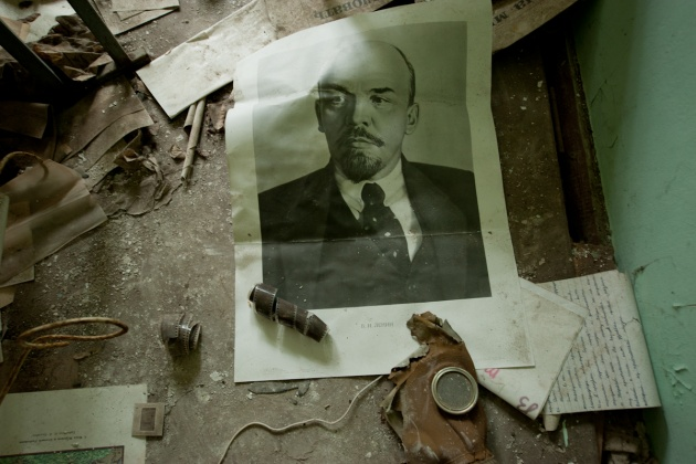 An old photo of Lenin, lying on the floor of a classroom in a school in Chernobyl
