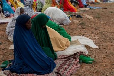 During the Salat, Friday prayers. Women sit behind men