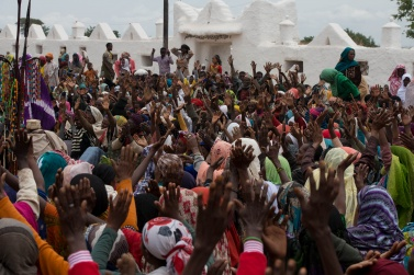 Encouraged by the words of the Daga, the faithful raise their hands to implore Allah through their holy Sheik Hussein