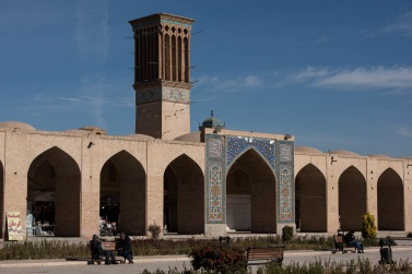 The central square of the Bazar e Sartasari of Kerman, one of the oldest Iranian bazaars. Highlights the typical wind tower, Badgir. From its cracks the air comes in to cool the inside of the house or shop, with a particular technique