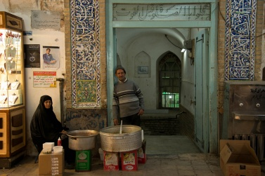 Husband and wife prepare quick meals for customers in the Yazd bazaar