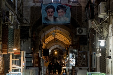 Bazar e Bozorg of Isfahan. The images of Khomeyni and the current Supreme Guide, Kamenei, are always present.