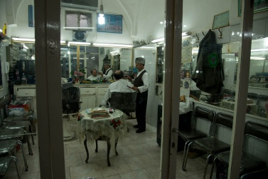 A barber inside the Kashan Bazaar. Bazaars are cities in the city, where any type of service is found