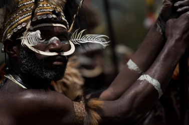 A Dani warrior, with the proud look typical of the men who live in the Baliem Valley, is concentrating to face the battle