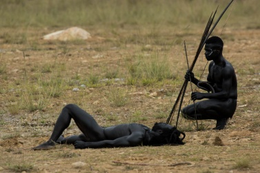A Lani warrior is lying on the battlefield. He was killed by a spear of the enemy. The battle stops, and everyone returns to their villages. But it is only a temporary respite