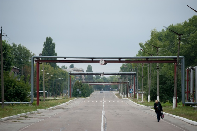 The main street of the city of Chernobyl. Pipes for heating gas can not be buried because the soil is still contaminated with radiation