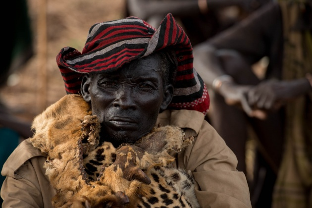 Tagiso is the Shaman of the Lilya village, and today he will direct the ceremony. He has just taken the place of the Shaman who died, and he inherited the leopard skin from him