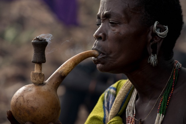 A woman who smokes local tobacco with a traditional pipe. This is a very frequent habit among women